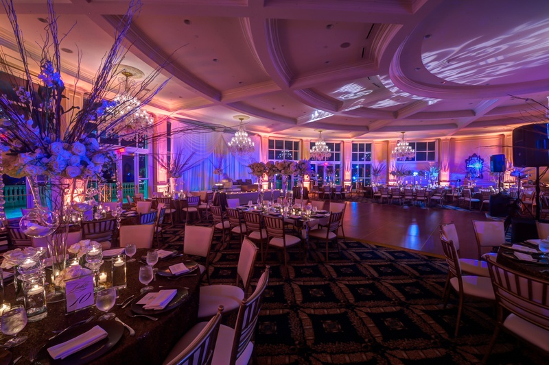ballroom reception with blue uplighting and patterned projections