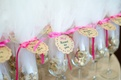 Bridal shower favors of champagne flutes filled with chocolate kisses tied with pink bows