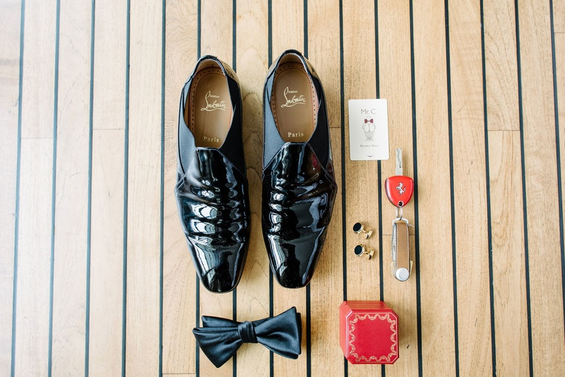 groom's patent leather dress shoes bow tie red ring box room key cuff links groom accessories