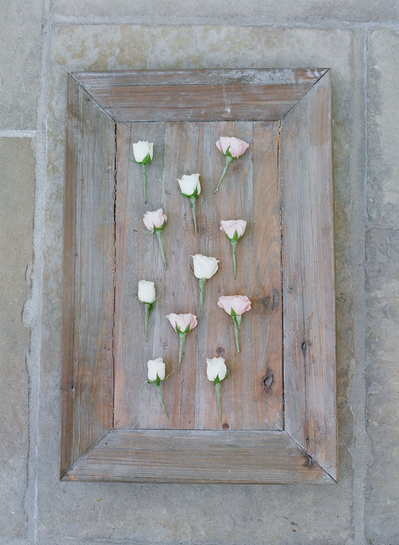 White wash wood tray with light pink and white rose boutonniere styles
