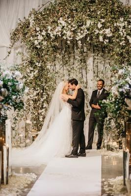 wedding ceremony white drapery greenery white flowers aisle runner flower petals former miss america