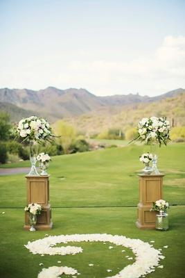 Silverleaf Club wedding ceremony with flower petal scroll design aisle and soft flower arrangements