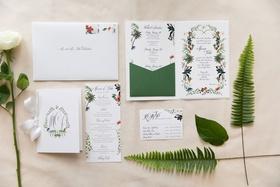 five part invitation suite with custom illustrations