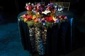 sweetheart table decorated with moss and colorful flowers