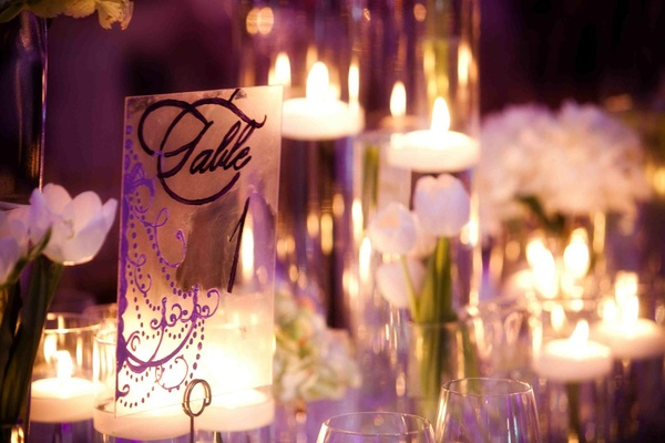 Wedding table number with monogram and purple chandelier