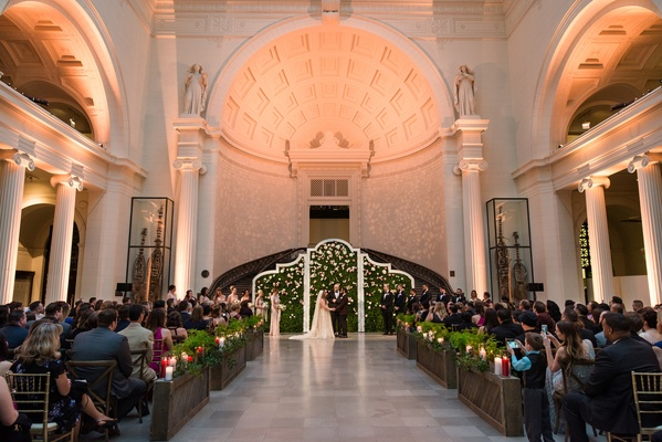 Chicago The Field Museum wedding with hedge wall ceremony altar backdrop and ferns along aisle