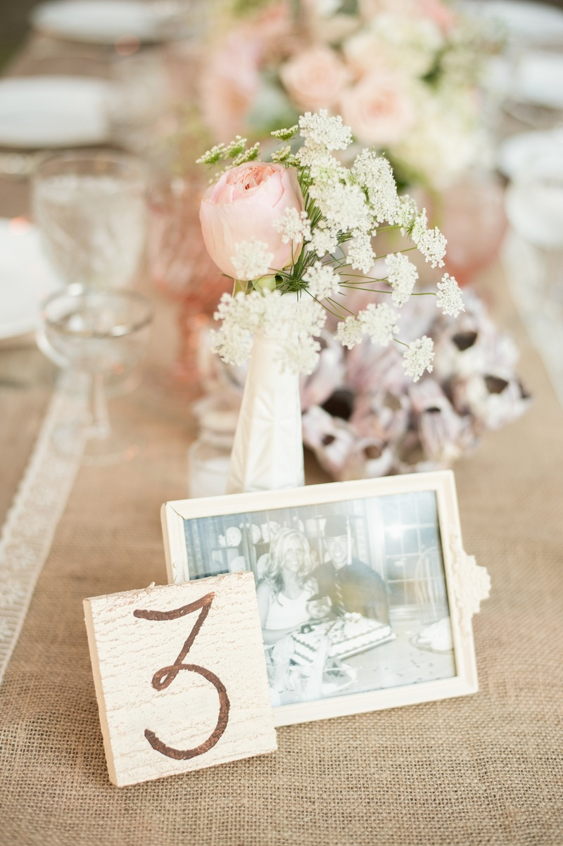 Reception Décor Photos - Rustic Table Numbers - Inside Weddings