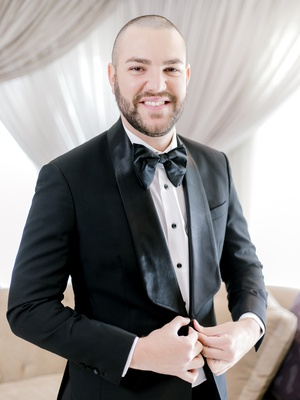 groom in malcolm alexander tuxedo, groom in black tuxedo with large bow tie