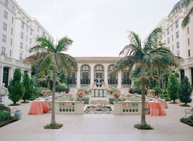 Wedding reception cocktail hour palm trees coral linens and flowers the breakers palm beach
