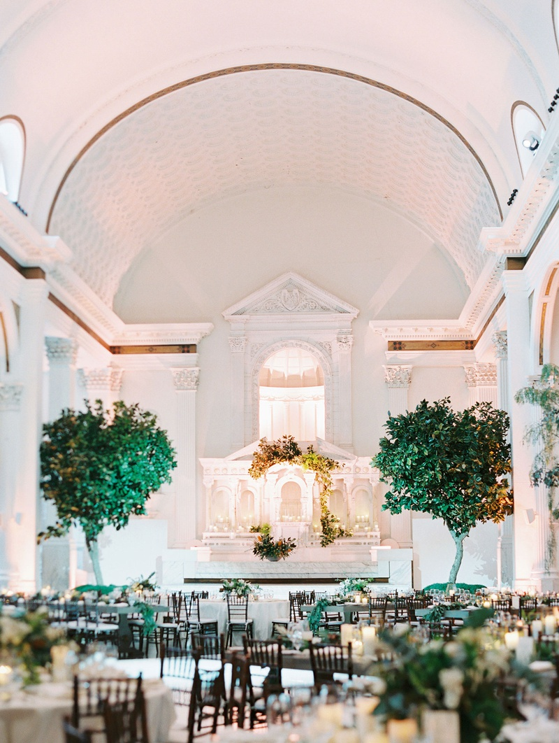 wedding reception at vibiana downtown los angeles venue trees framing altar low centerpieces white