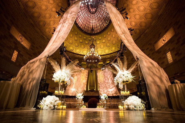 Wedding ceremony art deco vintage theme gotham hall new york city white flowers palm trees leaves