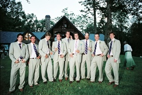 Men in khaki suits with purple ties outside