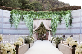 Skirball Cultural Center Jewish wedding ceremony outdoor greenery blush white flowers wisteria