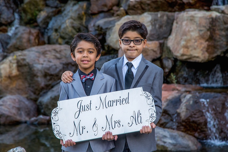 Young Indian boys holding handpainted sign