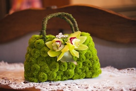 Purse made of green button mums and orchids