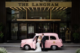 bride and groom with classic pink car for the langham chicago vehicle