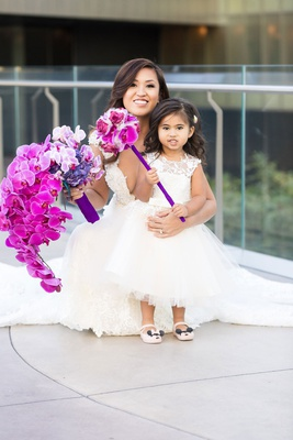 adorable flower girl with minnie mouse, fuchsia orchid pomander flower wand