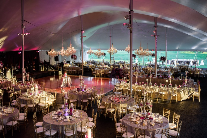 tented reception for large wedding, chandeliers, uplighting