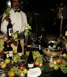 Wine station decorated with grapes and orchids