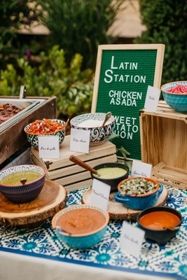 wedding reception food station latin food with letter board menu salsa in bowls mexican tile