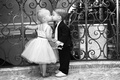 Black and white photo of flower girl and ring bearer kiss