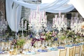 purple tapers candles, crystal candelabra, turquoise and periwinkle napkins