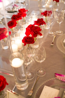 tablescape single red roses vases gray linens wedding reception california candles simple modern
