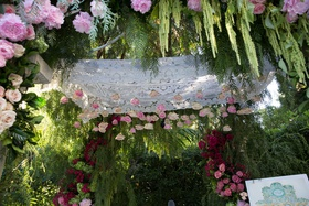 Wedding ceremony jewish pink white rose flowers hanging from canopy amaranthus pink rose