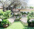 The Inn at Rancho Santa Fe outdoor wedding ceremony with greenery and pink and white flowers