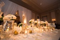 gold and ivory wedding head table, white drapery behind
