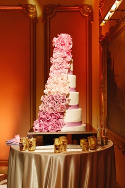 white cake with pink ribbons and ombre pin floral cascade
