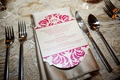 Wedding menu card in hot pink on satin napkin