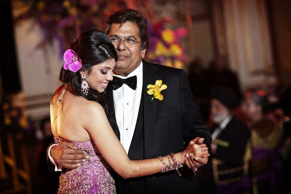 Indian bride with henna and dad dancing at reception