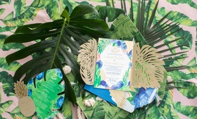 tropical invitation suite with blues, greens, and golds, pineapple insert, split leaf insert