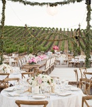 Twinkling lights overhead wood guest tables