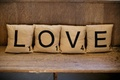 scrabble tile pillows spelling love, wedding lounge area