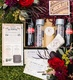 an assortment of paper goods and other items for a couples rustic european style wedding