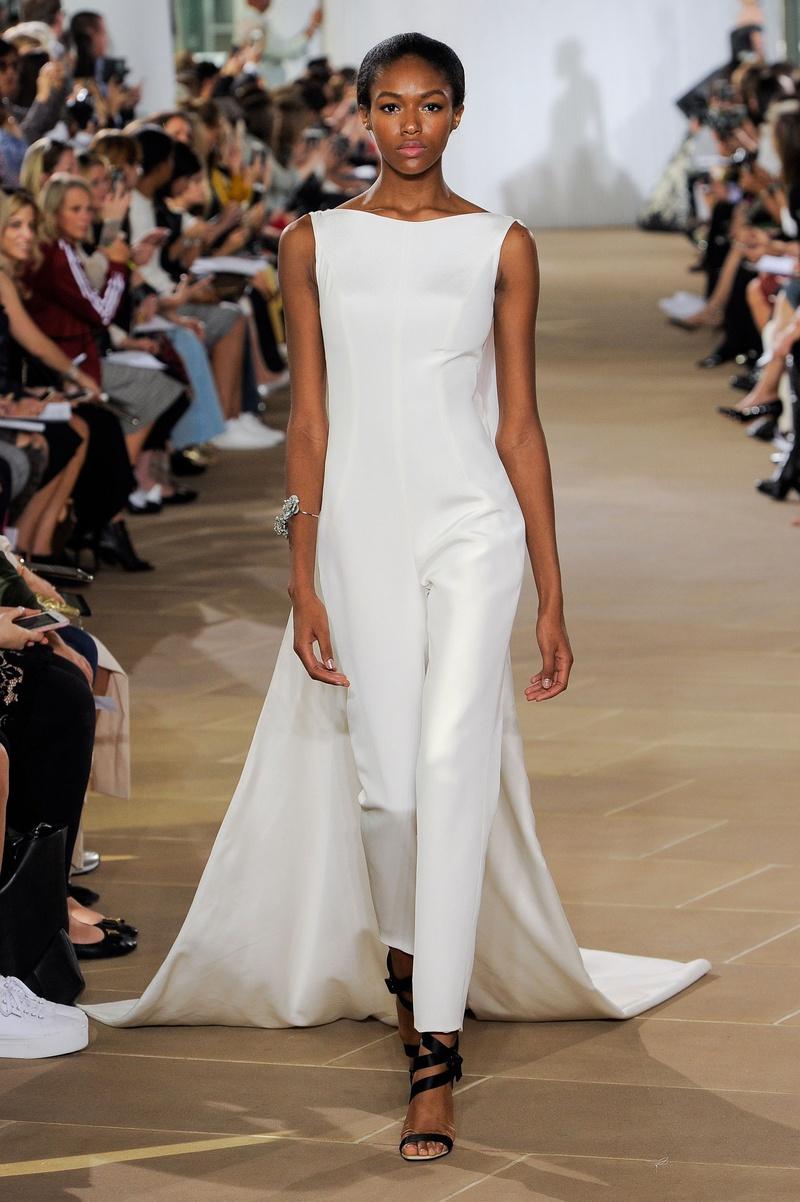 Ines Di Santo fall 2019 bridal collection wedding dress Rae, bateau neckline cigarette leg jumpsuit