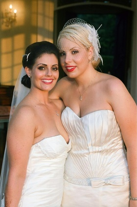 Lesbian couple in white wedding dresses