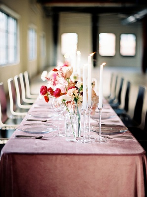 Wedding reception blush table linens velvet tall candles on clear crystal stands and pink red flower