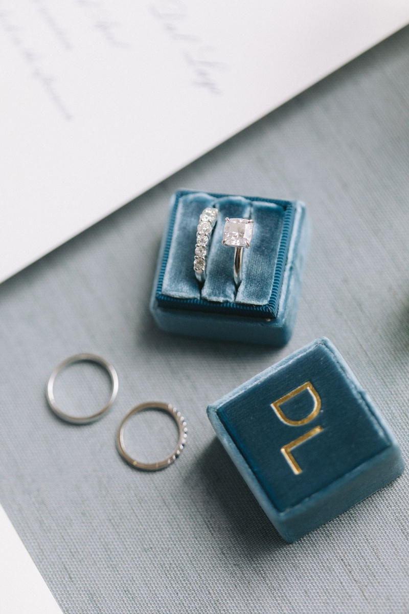 bride engagement ring and diamond wedding band in velvet ring box with last name initials in gold