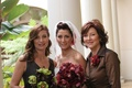 Bride with sister and mother of the bride in brown collared dress