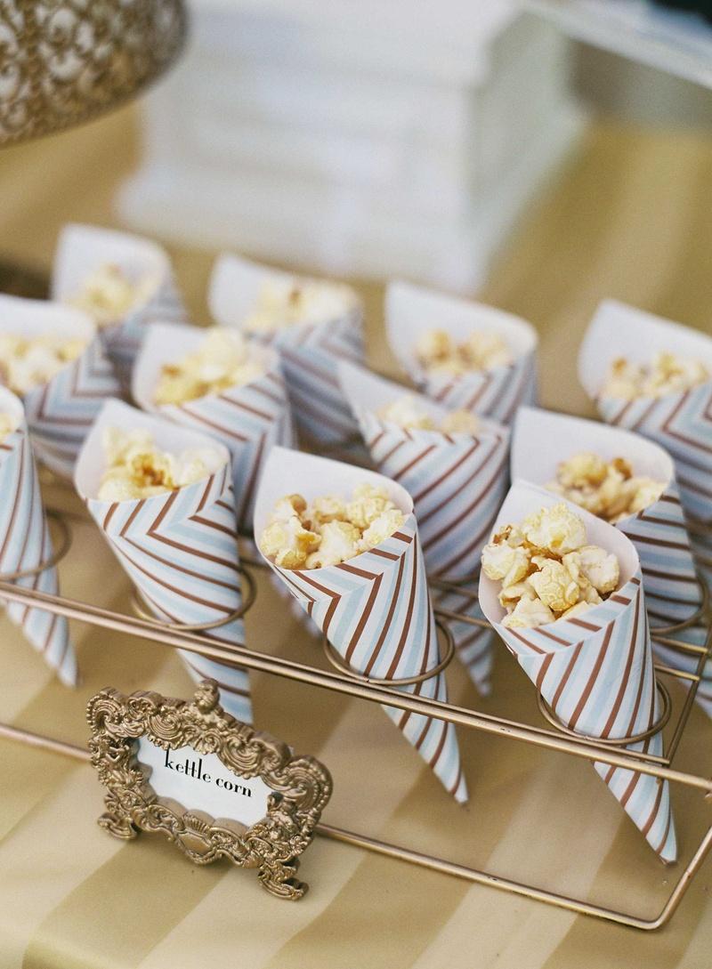 Wedding Dessert Receptions -  wedding reception dessert table with kettle popcorn served in striped cones