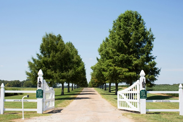 Upper brandon plantation in virginia white gate tree lined driveway