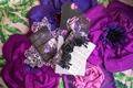 Wedding styled shoot dark beauty purple flowers invitation menu card gold calligraphy unicorn