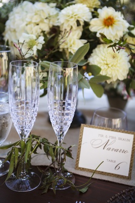 Bride and groom's crystal champagne flutes with modern design at ranch wedding reception