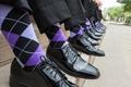 Groomsmen wearing black dress shoes and purple accessories