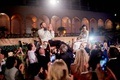 ringling museum wedding reception outdoors, bride and groom lifted in hora