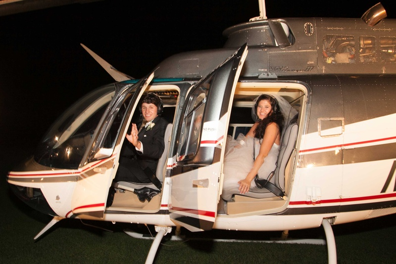 Groom And Bride In Monique Lhuillier Wedding Dress Inside Helicopter For Reception Exit