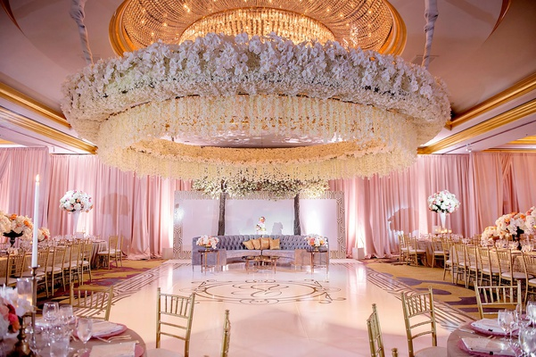 wedding reception orchid flower arrangement ceiling lounge area gold monogram dance floor